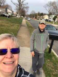 Photo of TechCommGeekMom and hubby walking in their neighborhood.