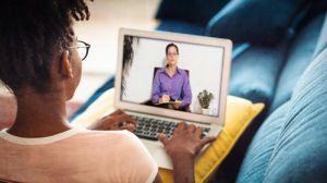 Woman talking to another woman in video conference call image